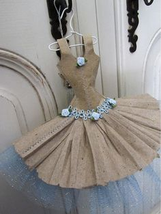 This adorable ballet style dress miniature is made from recycled paper with an underskirt of soft sparkly pale blue tulle.  It is carefully stitched in pale blue cotton with intricate trims glued in place.