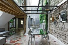 Though this Paris dining room is technically indoors, it feels like an extension of the adjacent courtyard thanks to a glass ceiling and walls.