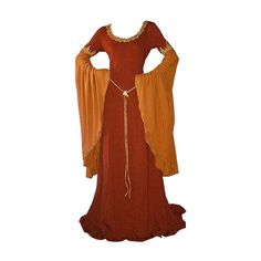 Wine and Gold medieval gown with gold trim. I love the way the fabric falls, it has a nice drape. I also love the drape of the sleeves. The colors blend nicely, as well.