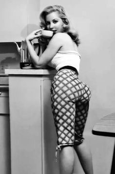 Betty Brosmer c. 1950's - this just convinced me to grow my hair out long again. and maybe i should be working out my ass.