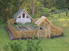 Chicken coop attached so they can enjoy the end of the harvest leftovers  fertilize at the same time. perfect.