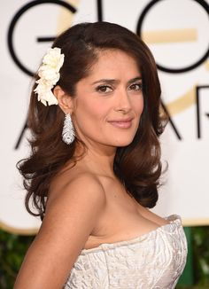 Okay, so Salma Hayek definitely doesn't have thin hair, but that doesn't mean this style isn't a great option for women who do! Adding a flower clip or other hair accessory to one side — then pulling the rest of your hair to the other — can actually bulk up your look, making it appear as though your have more volume than before.  - GoodHousekeeping.com