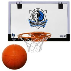 """NBA Dallas Mavericks Game On Indoor Basketball Hoop & Ball Set by Licensed Products. $25.00. Included with an inflatable 5"""" channeled basketball. Professional Grade Polycarbonate hoop set. Polyester Fiber Filled Ball - Molded Plastic Hoop and Backboard.  Nylon Netting.. Eqiupped with a unique break-way rim. This professional-grade polycarbonate hoop set comes equipped with a unique break-way rim.  Very easy to assemble and mount on door.  The backboard is 18"""" x 12""""..."""