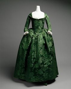 1775--American: Round Gown - The round gown was a simple style, similar to a Robe a l'Anglaise, with the exception that the skirt and petticoat are as one - it is not an open robe. Popular in the 1770s through the end of the 18th century, the round gown featured a front-closing bodice with no stomacher, and a drop-front skirt.