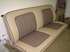 Cream and brown bench seat with red piping