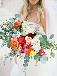 The prettiest color-happy bouquet: Photography : LESLIE D PHOTOGRAPHY Read More on SMP: http://www.stylemepretty.com/arizona-weddings/phoenix/2016/07/28/classic-elegant-arizona-wedding-with-pops-of-beautiful-color/