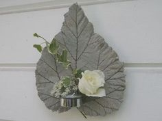 Make this leaf and then fire in our handmade kiln. It would come out then like Raku firing.