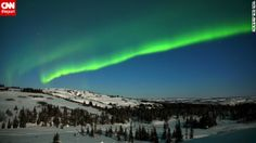 The lights of the aurora borealis shine bright in this 2012 photo by Tina Ball, who st...