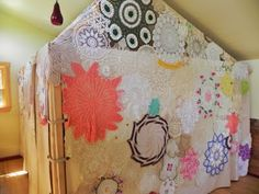 indoor play house covered with vintage linens and doilies.