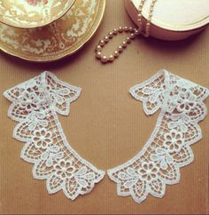 Pair of embroidered guipure lace collars White cotton yarn Each collar has an internal neck measurement of 20cm, 40cm per pair, and are 5.5cm at the widest point. The price is per pair Please adjust the quantity if you would like more than 1 Please contact me for wholesale shipping rates for multiple pieces Shipping from the UK  Ideal for garment customisation; dresses, blouses, tops etc.  Fashion Trims is based in Leicestershire, the textile capital of the UK. We specialise in lace trims…