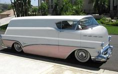 Appears to be the unholy alliance of a '56 Chevy Bel Air, a Chevy Stepside delivery van and a Buick. Hmm...