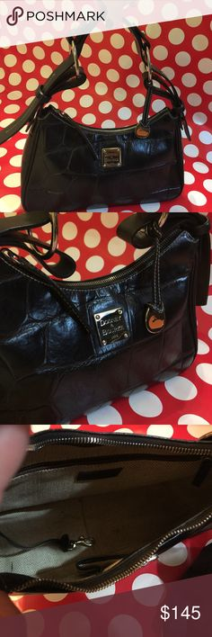 Dooney & Bourke This is a used black leather bag in well cared for condition. It has a couple of small marks inside but comes from a smoke/pet free home. Dust bag included. Dooney & Bourke Bags Shoulder Bags