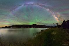 Why would the sky look like a giant fan? None other than airglow of course! The featured intermittent green glow appeared to rise from a lake through the arch of our Milky Way Galaxy, as captured last...