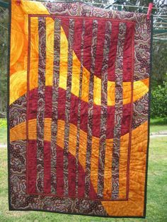 """I finished quilting and binding the """"Cosmic Curves"""" convergence quilt the other day. I used a lot of gold metallic thread and did free motion embroidery for the sun … Bargello Quilt Patterns, Bargello Quilts, Modern Quilt Patterns, Scrappy Quilts, Jaybird Quilts, Modern Quilting, Crazy Quilting, Mini Quilts, Baby Quilts"""