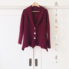 || Free People || Far Away Cable Cardigan Completely sold out Free People Far Away cable cardigan in Burgundy. Soft, comfortable, super warm sweater with chunky cable detailing. Flares out and drapes nicely at sides. The size tag has fallen off but it is a size S. Would fit an XS or M depending if you prefer an oversized or more fitted look. There is a small hole above the right shoulder but it's barely noticeable and cannot be seen when worn because the shawl collar conceals it. This has…