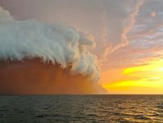 Cloud Formation tinged with red dust travels across the Indian Ocean.