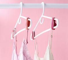 Rubber bands wrapped around the ends of hangers to keep slippery camisoles and sweaters from falling off