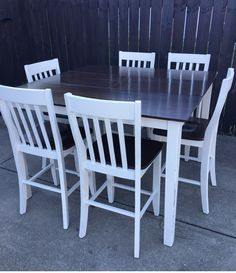 Completely refinished wood counter height modern farmhouse style dining table. With butterfly leaf in center so it is easy to make larger for company. Includes 6 chairs! Base and chairs painted in cream white color and lightly distressed for rustic. Top of table and chairs stained with Java gel and has top coat sealant.
