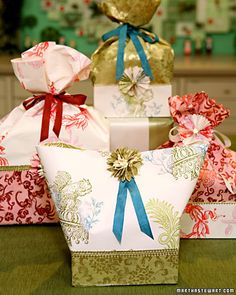 Holiday Gift Bags  These beautiful bags are made by gluing decorative paper and strips of foil-embossed Dresden paper around low-sided boxes. Fill the bags with wrapped homemade candy or cookies. (Martha Stewart)