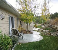 Curvy side walk to garage door from patio.  Google Image Result for http://media.onsugar.com/files/2010/12/49/3/628/6288283/image_0.preview.jpg