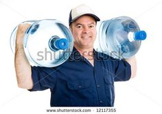 Stock photo : strong water delivery man smiling as he carries two full five gallon water jugs on his shoulders.  isolated on white.