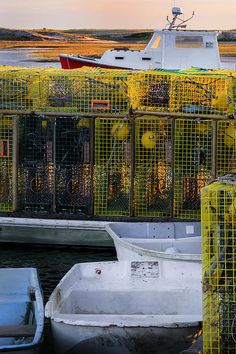 Lobster traps stand ready to head out for some fresh New England lobster, at Pamet Harbor,Truro Cape Cod MA.