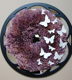 My take on a coffee filter wreath.  Dyed unbleached filters with watered down acrylic paint.  The butterflies are from the floral department at Hobby Lobby and then painted white.  Love it for spring!