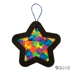 You'll love how the colors play on your tree when you use this Tissue Paper Star Ornament Craft Kit. A great Christmas craft project for you...
