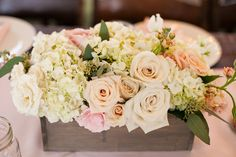 Thinking about a spring wedding? We love the fresh spring look a gorgeous blush pink and cream floral arrangement create!