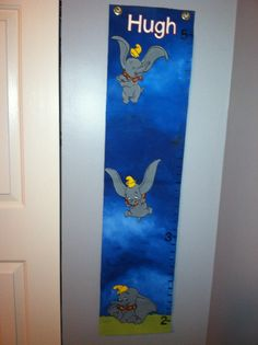 Hand painted by family friend. Height chart made just for Dumbo nursery.