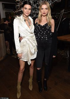 Belt up: Kendall Jenner wore a revealing silk jacket as she posed with a stunned Lily Donaldson at the Valerian And The City Of A Thousand Planets teaser premiere in LA Monday