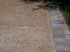 exposed aggregate driveway with paver border - Google Search