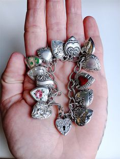 Vintage 1940's puffy heart charm bracelet 13 repousse enamel and guilloche hearts sterling silver Walter Lampl padlock loaded by TrueBlueDryGoods on Etsy https://www.etsy.com/listing/521167999/vintage-1940s-puffy-heart-charm-bracelet