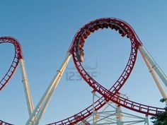 A modern roller coaster in a theme park. Stock Photo