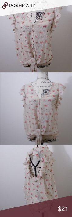 """sz. large - Potters Pot sheer ruffle blouse Potters Pot short sleeve sheer draped ruffle blouse. cream with pink floral design. button up front with front hem tie detail. dry clean only.   size large - 20"""" pit to pit, 37"""" length  See photos for details. Smoke free, pet friendly home.   Please message me with any questions. Ask if additional size detail is needed.   15% discount for 3+ item bundles. Check out my closet. Happy Poshing!  589/CL Potter's Pot Tops Blouses"""