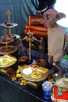 Dobby overseeing the sweets table from Gryffindor Harry Potter Birthday Party at Kara's Party Ideas. See over 50 pictures at karaspartyideas.com!