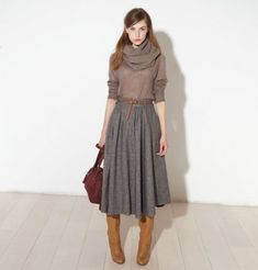 Like the muted tones, skirt with boots, overall cozy-but-put-together look