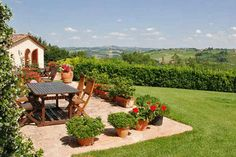 tuscan decorating ideas | Outdoor rooms decor, backyard ideas, Tuscan decorating with flowers