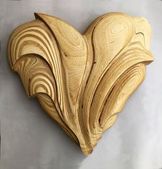 Birch Heart by Kerry Vesper. Abstract heart sculpture is hand carved in layered Baltic birch. Sanded and finished with tung oil/urethane. Simple Wood Carving, Dremel Wood Carving, Wood Carving Art, Chainsaw Wood Carving, Carved Wood Wall Art, Wooden Art, Hand Carved, Wood Carving Designs, Wood Carving Patterns