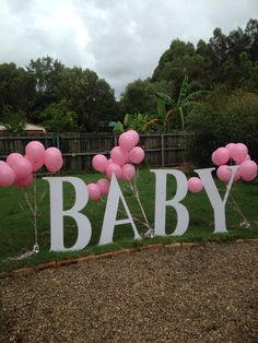 A balloon release and my BABY sign were great additions to this baby naming ceremony I performed for the couple in their parents backyard.