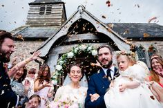 Elegant bride closing her eyes amidst the chaotic and colourful display of confetti at Dewsall Court in Herefordshire Creative Wedding Photographer © Babb Photo.
