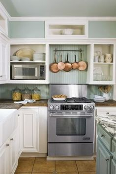 Kitchen Remodeling on a Budget. I like the microwave off the counter.  Hmmm...  Makes me think about something for our microwave... I don't love where it is now...