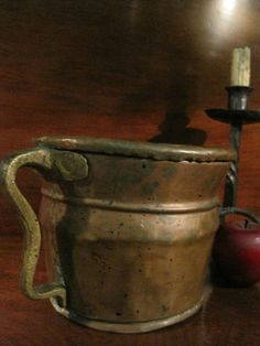 Antique 1700s Colonial Tavern Hand Wrought Copper  Dovetailed  Pouring Ewer Flagon Pitcher Vessel with Large Brass Handle and Copper Rivets. This would have held beer or spirits and pour for tavern patrons.  22 inches circumference around the rim.   For Sale North Bayshore Antiques