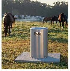 Nelson drinker/automatic waterer mounted to a concrete pad.  Comes in stainless steel and aluminum.  Energy efficient.  They supply fresh water to your animals everytime they drink, and they are easy to clean with a stainless steel removable bowl.