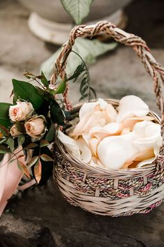 12 Flower Baskets Your Flower Girl Will Love ~ Cool basket to carry flower petals with roses and greens off to one side: Cedarwood Weddings; Nyk & Cali