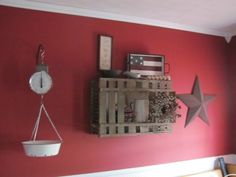 I <3 red... And with the rusticity decor... LOVE! My Living room may just have to be this color ;) With white book shelfs instead of black...