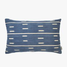 Our eye catching Abuye Indigo Lumbar Pillow from Bryar Wolfwill add a global vibe to any space. Perfect for layering with a variety of pillow styles, this authentic West African indigo cotton pillow is a perfect complement to any decor. Includes a down feather insert.