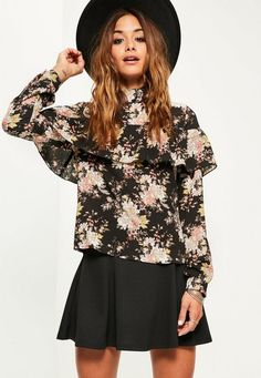 Need a wardrobe revamp in-between seasons? Snap up this dark floral blouse with its blouse style, frill overlay and high neck.