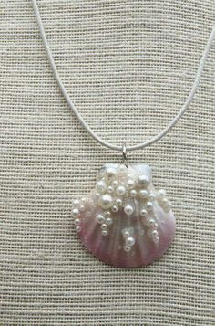 Real sea shell , airbrushed in soft pink and pearl. Faux pearls and iridescent tiny glass balls added for a unique look. Resin coated for increased strength. At widest measures Comes with pearl leather cord. Seashell Jewelry, Seashell Art, Seashell Crafts, Beach Jewelry, Wire Jewelry, Jewelry Crafts, Jewelery, Handmade Jewelry, Seashell Necklace