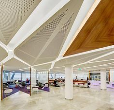 Feature Ceiling | Key-Lena solid and perforated custom shaped MDF panels | Virgin Australia Lounge, Sydney Airport | New South Wales